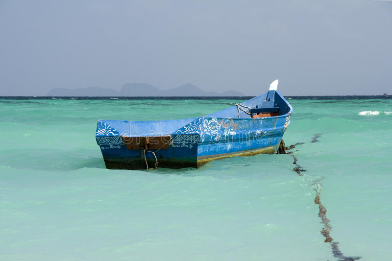 Boat. Small Thai boat in clear blue water stock photos