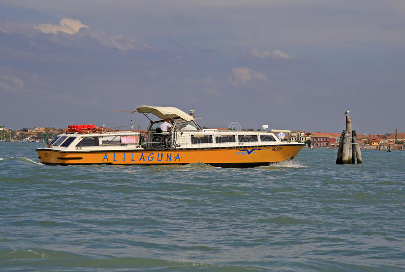 The boat Alilaguna in Venetian lagoon in Venice, Italy royalty free stock images