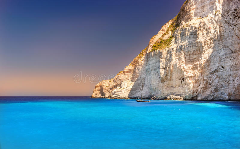 Boat anchored on Navagio beach (also known as shipwreck beach), Zakynthos island, Greece stock image