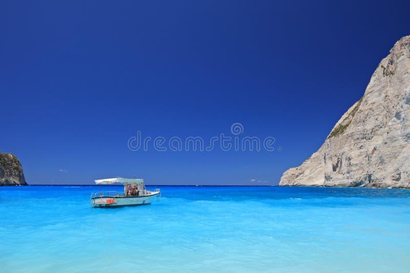 Boat anchored on Navagio beach, Zakynthos island royalty free stock photography