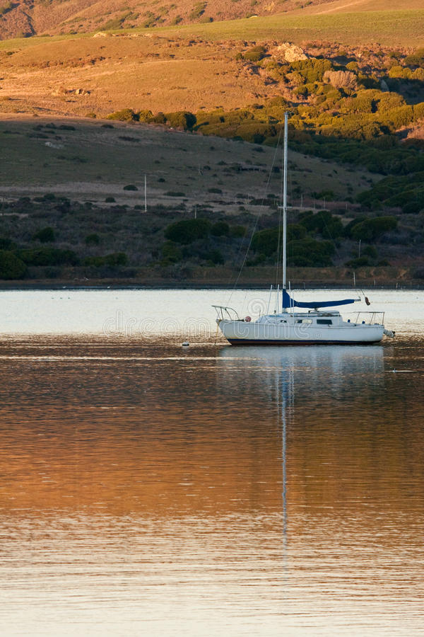 Boat Anchored in Tomales Bay at Sunset royalty free stock photo