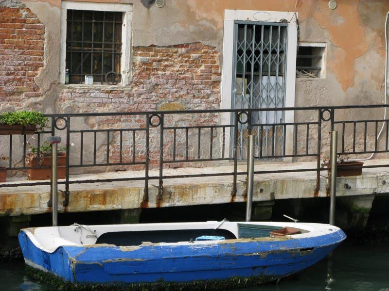 Boat awaits passengers in historic Venice, Italy royalty free stock photography