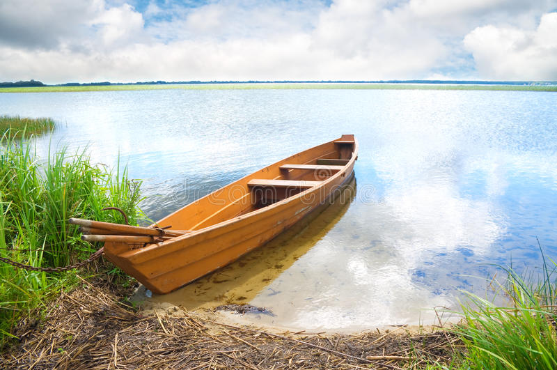 Boat on the bank of lake royalty free stock photos