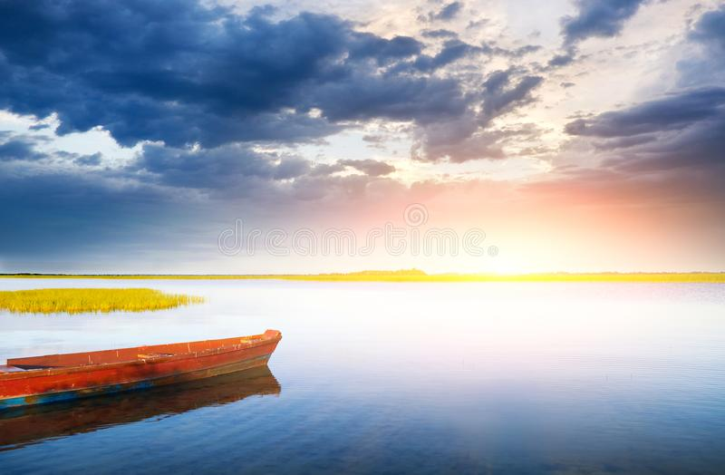 Boat on the bank of lake stock image
