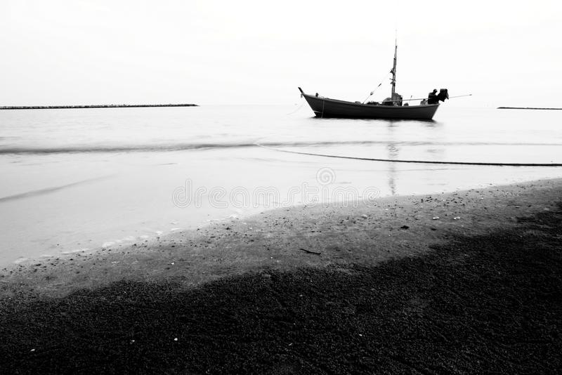 Boat On The Beach Black And White Picture Stock Photos
