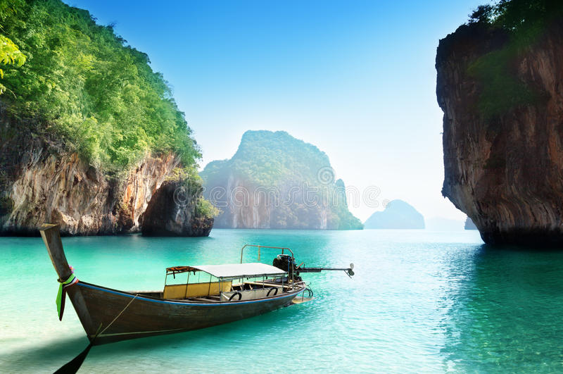 Boat on small island in Thailand royalty free stock photos