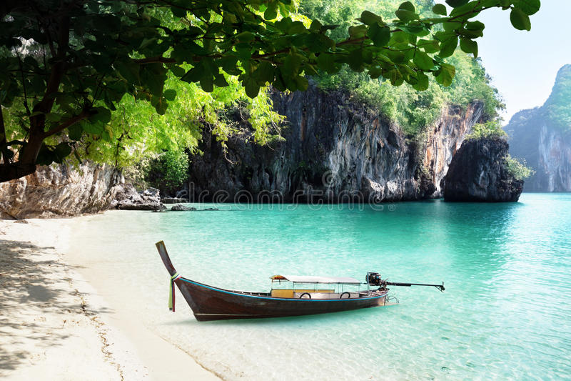 Boat on beach of island in Krabi, Thailand stock photo