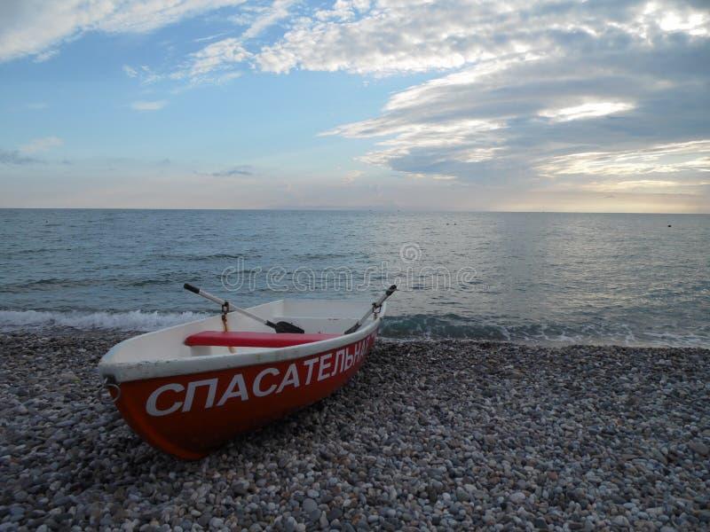 Boat on the beach stock photos