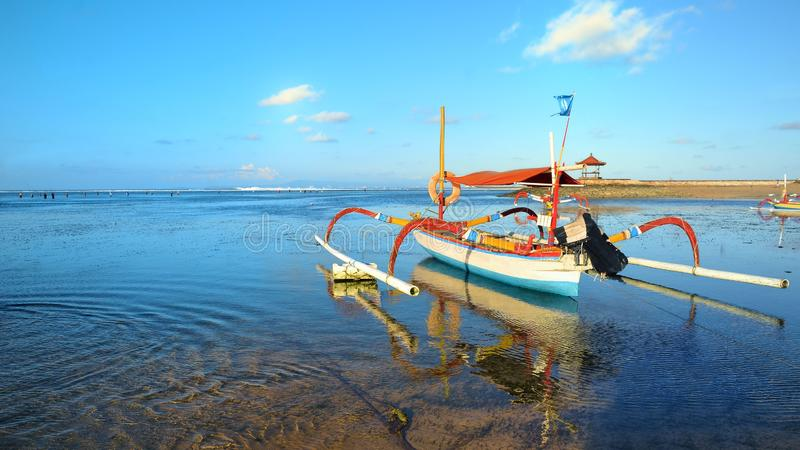 Boat on beach in sunset time at low tide stock image