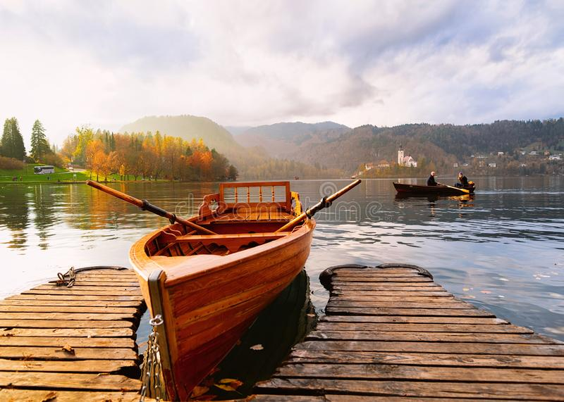 Boat in Bled Lake in Slovenia at sunset stock image