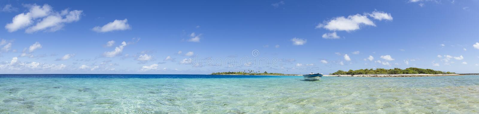 Boat on blue lagoon panoramic view royalty free stock image