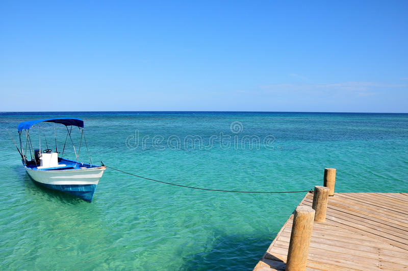 Boat in blue water royalty free stock photo