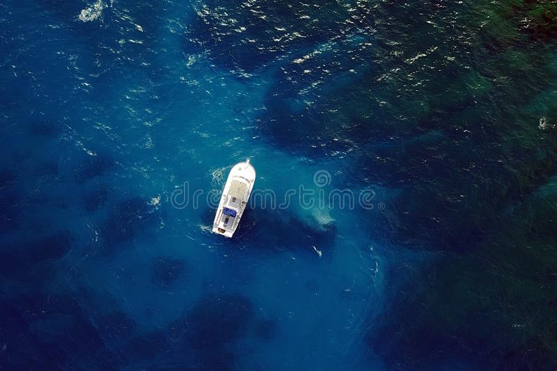 Boat in blue waters royalty free stock image