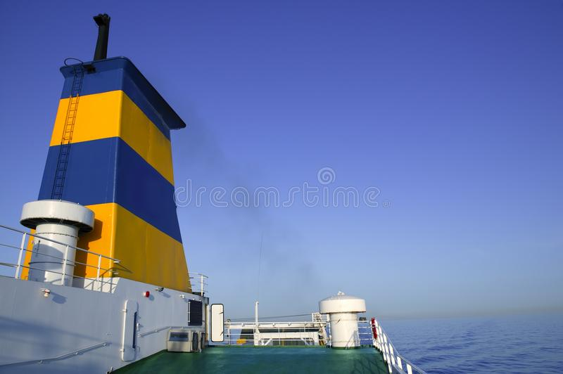 Boat bow in colorful yellow and blue colors. Turquoise sea stock photography