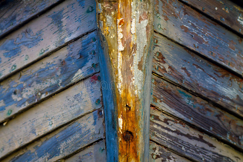 Boat bow. Peeling grey paint on bow of boat stock image