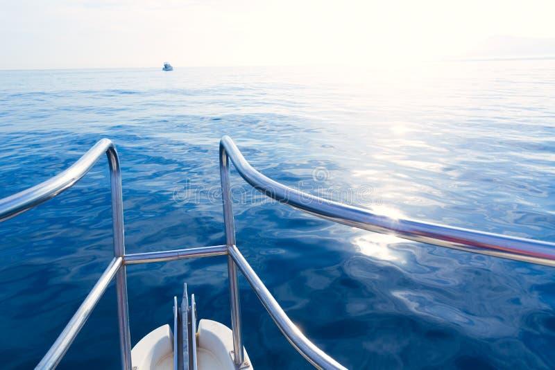 Boat bow sailing in blue calm sea. Ocean at blue Mediterranean stock photos