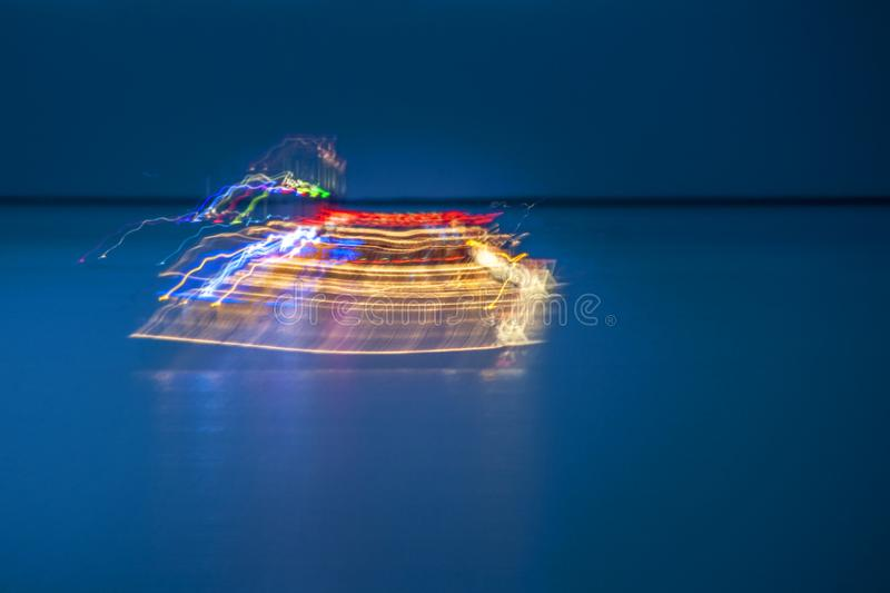Party boat on the ocean blur stock photo