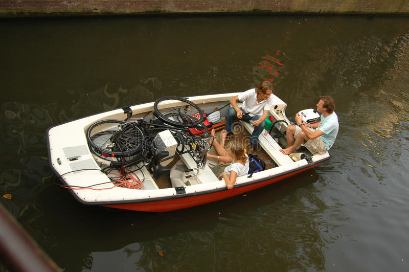 Boat on a canal in Amsterdam royalty free stock photo