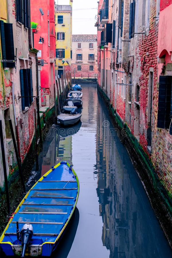 Boat in the Canals of the City,parked in fron of owner`s house. Venice / Italy 19 february 2019 :boat in the Canals of the City,parked in fron of owner`s house royalty free stock photo