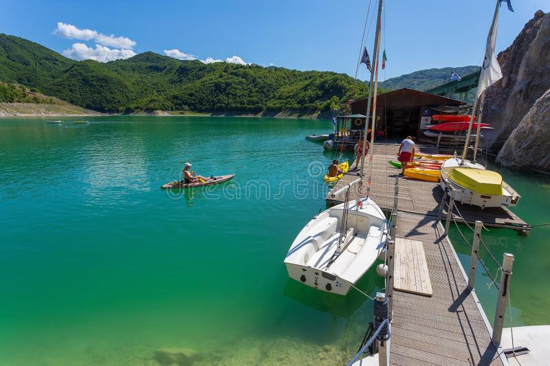 Boat and canoe rentals on Lake Turano, Italy stock images