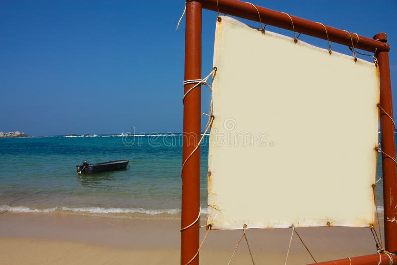 Boat in caribbean beach & sign. Tayrona, Colombia stock photo