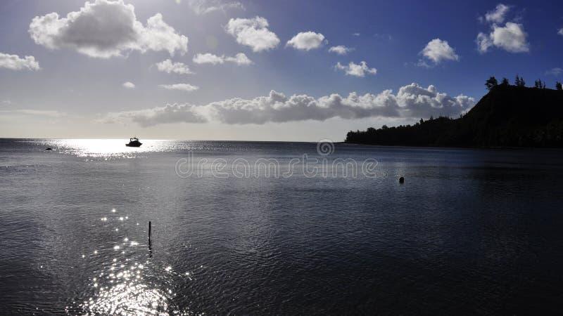 Boat in Cetti Bay stock photo