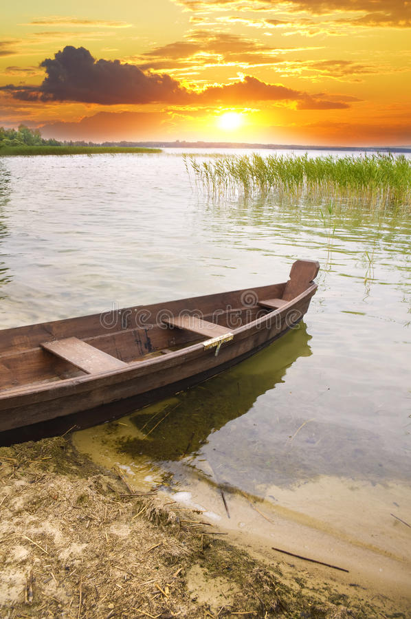 Boat at coast against a sunset. royalty free stock images