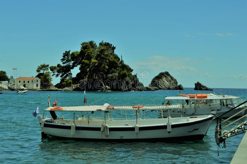 Boat on the coast of the Ionian Sea of Greece Parga royalty free stock photo