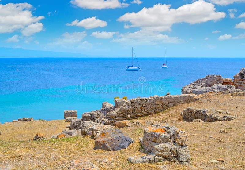 Boat by the coast in Tharros stock photos