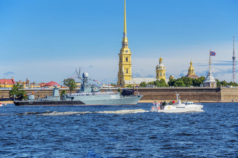 The boat of the commander-in-chief of the Navy makes a detour around the front line of ships on the day of the Russian Fleet. SAINT-PETERSBURG, RUSSIA - JULY 23 stock image