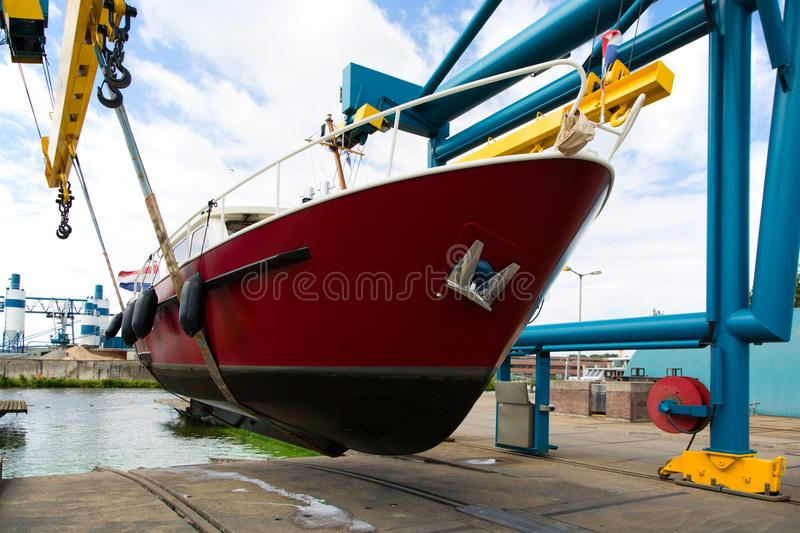 Motorboat on a crane royalty free stock images