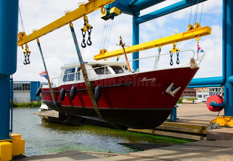 Motorboat on a crane stock images