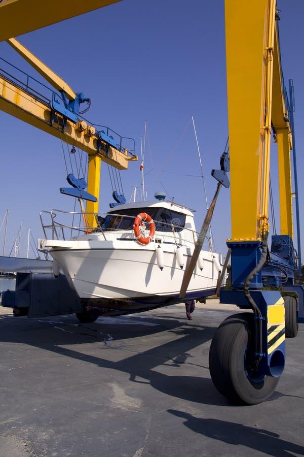 Boat crane travelift lifting motorboat stock photo