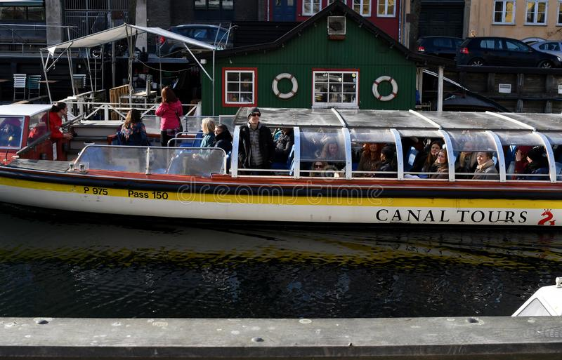 Boat crusing and visitors day on Christianshavn canal royalty free stock photo
