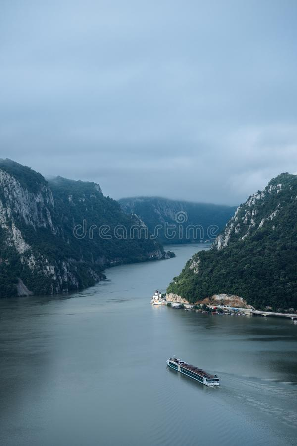 Danube big boilers between Romania and Serbia border with Mraconia monastery on the right royalty free stock photography