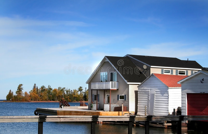 Boat Dock. And house at copper harbor Michigan royalty free stock photography