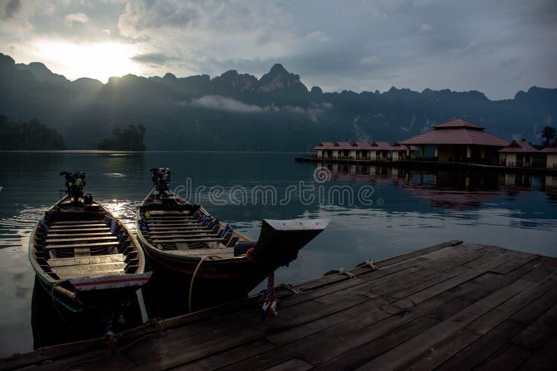 Boat dock at bamboo raft stock image