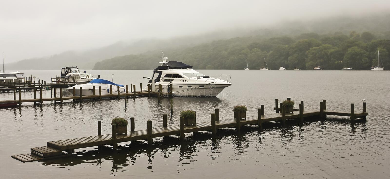Download A Boat Dock On A Misty English Lake Stock Image - Image of lakes, countryside: 26560037
