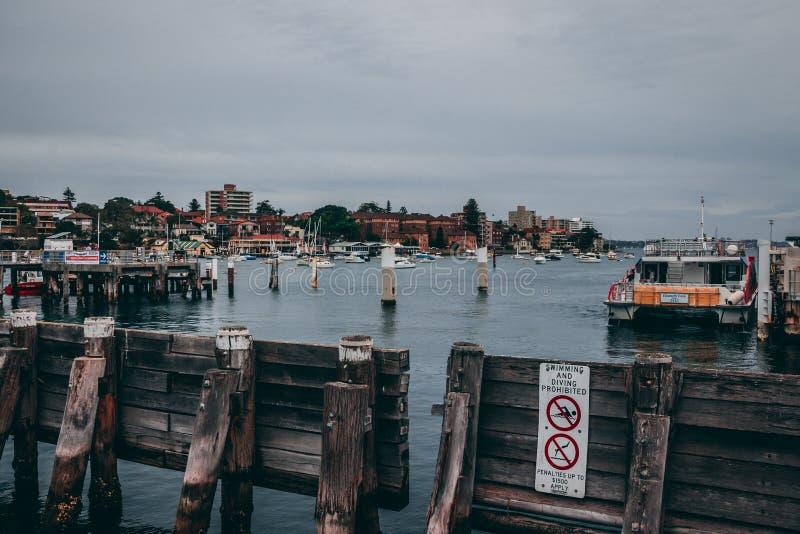 Boat Beside Dock Near Gray Post stock photos