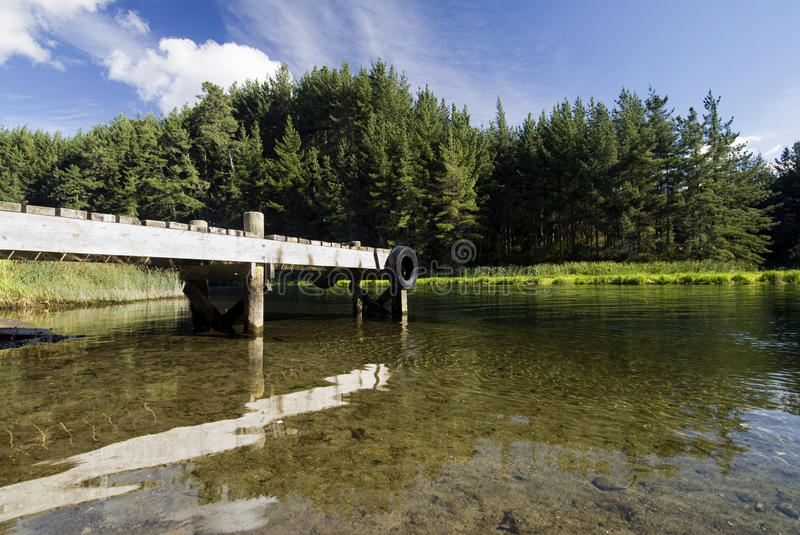 Boat Dock With Pine Trees Stock Image