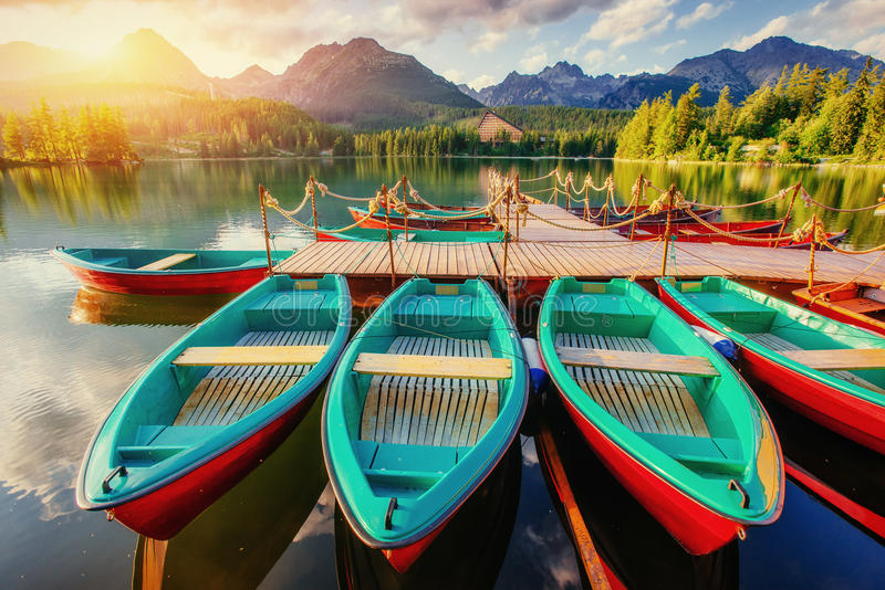 Boat on the dock surrounded mountains. Fantastic Shtrbske Pleso. High Tatras. Slovakia, Europe royalty free stock photography