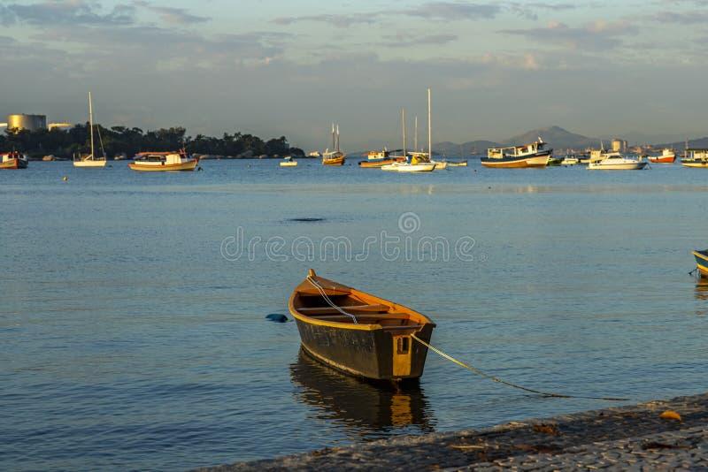 Boat docked. Wooden boat docked in calm sea. Brazil stock images
