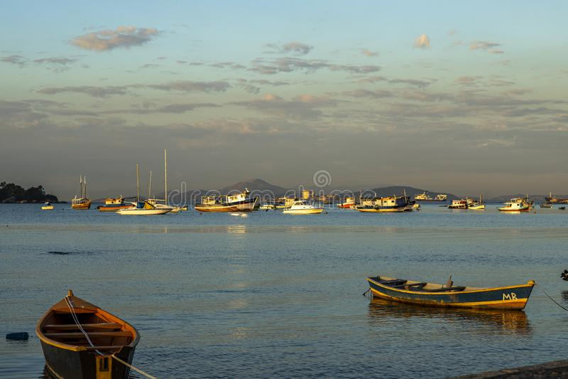 Boat docked. Wooden boat docked in calm sea. Brazil stock image