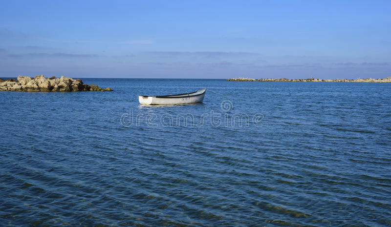 Boat drifting on sea royalty free stock images