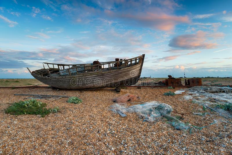 Boat at Dungeness in Kent. Abandoned boat at Dungeness on the Kent coastline stock photography