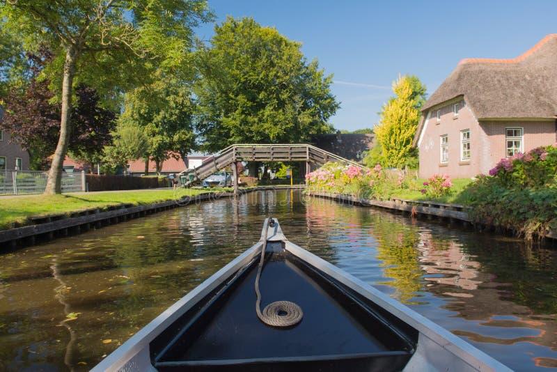 Boat in Dutch village Giethoorn stock photos