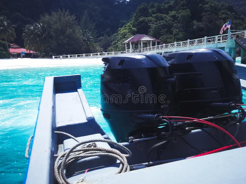 Boat engine in motion at the tropical sea stock image