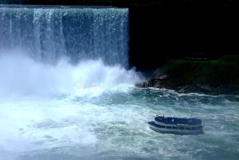A boat entering Niagara waterfalls royalty free stock photo