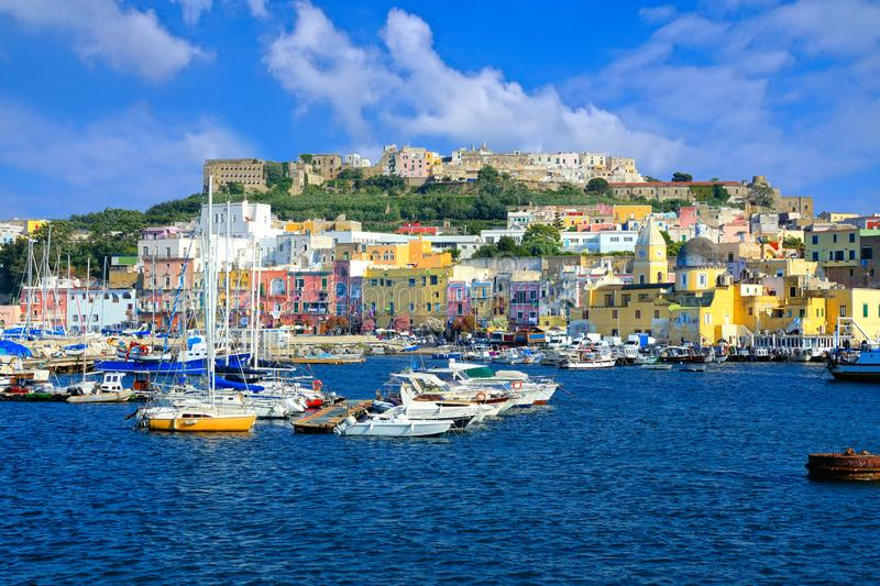 Boat filled port of the colorful island of Procida, Italy stock images