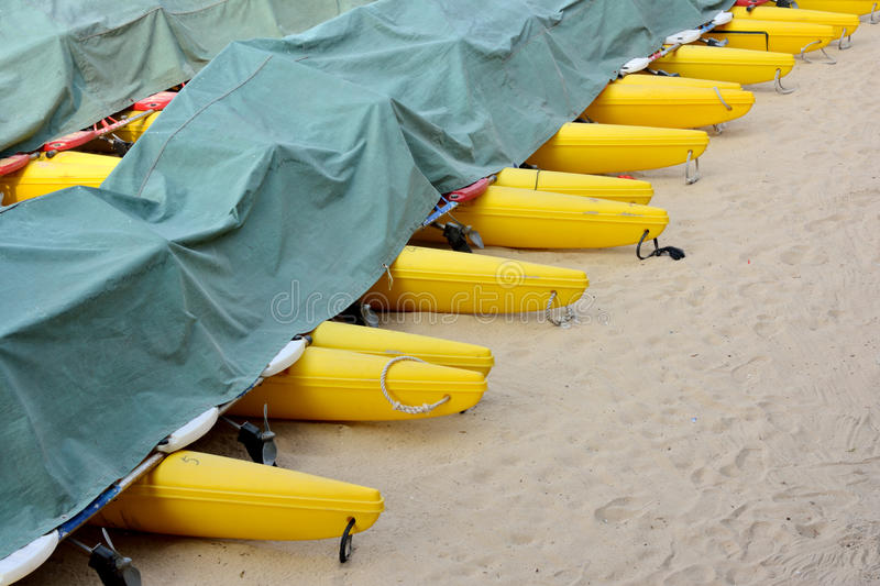 Boat floater on sand with cover